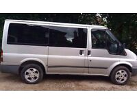 Silver 9 Seater People Carrier With Removable Seats