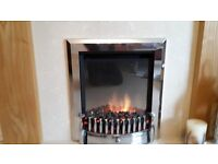 Feature electric fire with marble hearth and timber fire surround