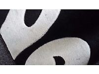 230cm x 160cm second hand black and white rug. No longer required. Buyer collects.
