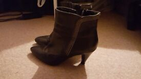 Black leather low boots