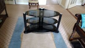 attractive TV stand with 3 glass shelves in as new condition