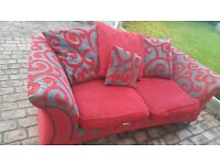 Two seater red sofa and chair
