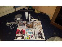 Nintendo Wii Bundle (Official Wii Controller, Nunchuck, Sensor, 6 Games)