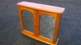 Solid pine bathroom cabinet with mirrored doors