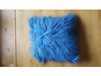 Ideal for childs room! Blue Fluffy cushion. £1