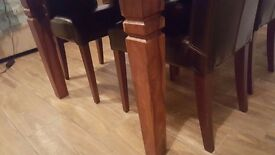 Lovely solid wood table (with extensions) and 6 chairs for sale.