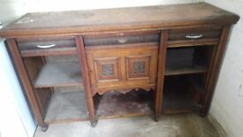 Wooden sideboard. Ideal restoration project. Would look good in a hallway or make an ideal wrkbench.