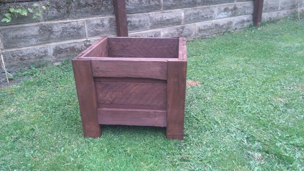 """Rustic handmade wooden plantersin Stanley, West YorkshireGumtree - Handmade rustic wooden planter 18"""" 16"""" 15""""high Finished in Ronseal dark oak wood care Very strong Good value Thanks for looking"""