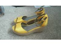 Designer wedge shoes by Fergie. Size 5