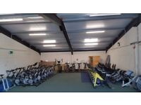 Warehouse filled with spinning bikes