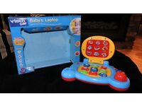 BOXED VTECH BABYS LAPTOP MUSICAL & LIGHTS UP RRP£20.00