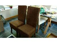 Two lovely wicker chairs from next