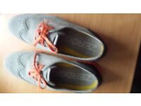 Cole Haan grey and orange lunar glide shoes