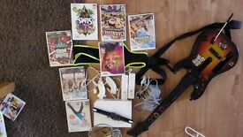 Nintendo wii with with 2 set of remotes, guitar hero guitar, zumba plus games