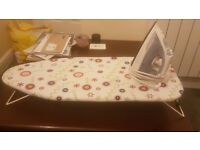 Small ironing board and iron
