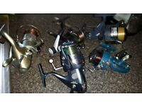 5 fishing reels with line