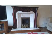 Solid mahoganny/solid marble fireplace.