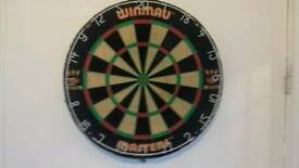 Winmau dartboard two sets of tungsten darts.
