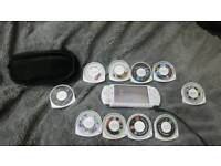 Psp wifi with games,charger and case