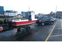 18 ft fishing boat with 25 hp Mercury outboard