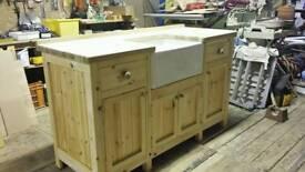 Solid wood oak topped sink unit.