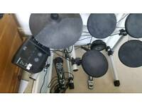 Electric drum kit with amplifier