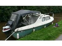 16ft maryland cabin cruiser with Honda 15hp four stroke outboard on the Mon and brec canal