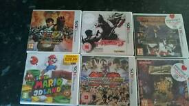 6 empty Ds game boxes