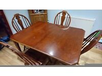 Solid mahogany extending dining table and chairs by Universal Furniture Ltd