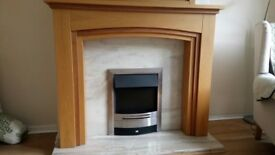 Solid oak fire place, marble surround and hearth and electric fire. Matching solid oak mirror .