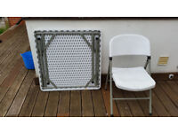 For sale a white outdoor foldable table and chair