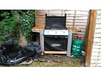Outback gas bbq with cover and gas.