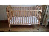 a baby / toddler cot bed