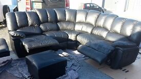 Black leather sofa chair and foot stool