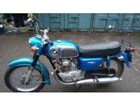 2 classic motor bikes