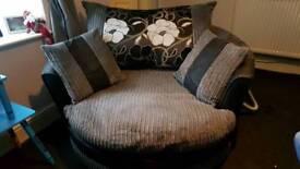 Grey corner settee and grey swivel chair