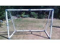 small plastic football goal, damaged net