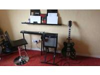 Gets her guitar, Revelation Lapsteel and Fender Mustang Amp