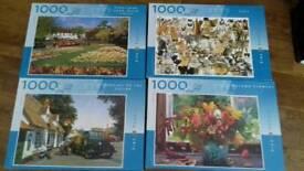 Four 1000 piece puzzles