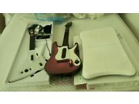 Xbox guitar controllers X2 and Wii balance board