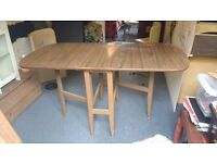 Brown Gate Leg Dining TABLE (laminate) pending collection
