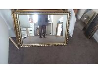 Large gold patterned mirror