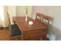 dark wood table with four matching chairs.