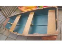 Wooden row dinghy