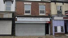 Three bedroom unfurnished flat above shops in Grimsby. Available immediately, NO Bond.