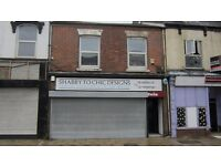 Three bedroom unfurnished flat above shops. Available immediately, NO Bond.