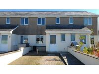 A modern spacious 2 Bedroom terraced house, unfurnished, off street parking.