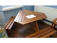 GARDEN TABLE WITH FIXED SEATING