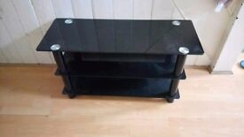 3 Tier Black Glass tv stand in Excellent condition