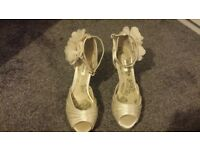 Cream shoes size 6